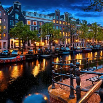 Houseboats in Amsterdam canals in the Netherlands